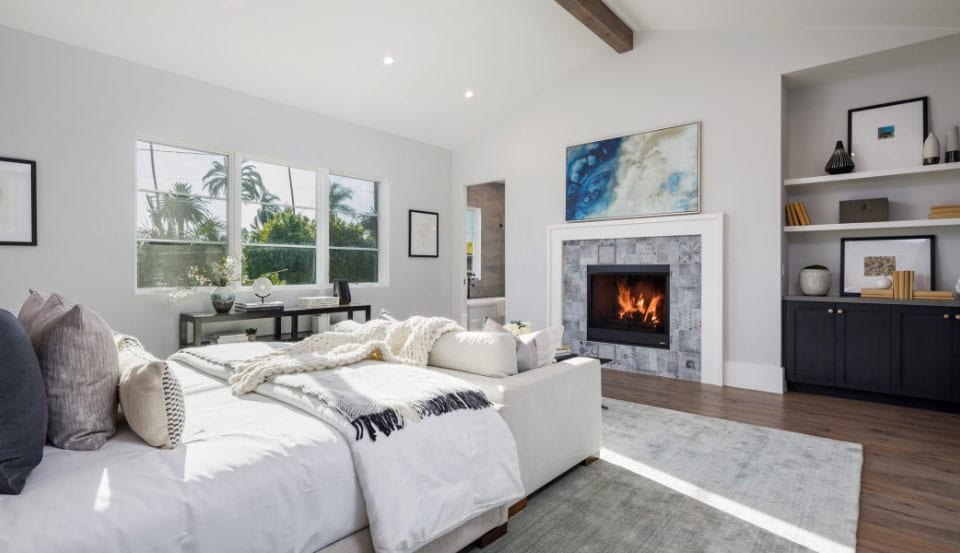 master bedroom with fireplace and built in shelves
