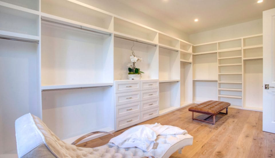 walk-in closet with sitting areas